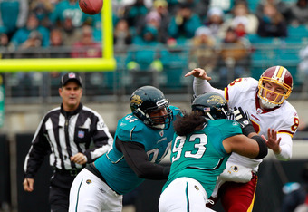 JACKSONVILLE, FL - DECEMBER 26:  Quarterback Rex Grossman #8 of the Washington Redskins is pressured by Tyson Alualu #93 and Jeremy Mincey #94 of the Jacksonville Jaguars during the game at EverBank Field on December 26, 2010 in Jacksonville, Florida.  (Photo by Sam Greenwood/Getty Images)