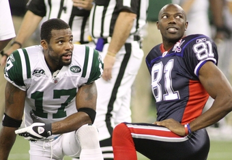 TORONTO - DECEMBER 3: Braylon Edwards #17 of the New York Jets and Terrell Owens #81 of the Buffalo Bills look on during a stop in play at Rogers Centre on December 3, 2009 in Toronto, Canada.  (Photo by Rick Stewart/Getty Images)
