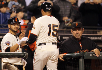 SAN FRANCISCO, CA - AUGUST 24:  Carlos Beltran #15 of the San Francisco Giants is congratulated by Cody Ross #13 and manager Bruce Bochy after he hit a home run in the fourth inning against the San Diego Padres at AT&T Park on August 24, 2011 in San Francisco, California.  (Photo by Ezra Shaw/Getty Images)