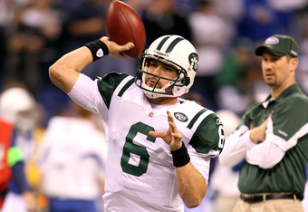 INDIANAPOLIS, IN - JANUARY 08:  Quarterback Mark Sanchez #6 of the New York Jets warms up as offensive coordinator Brian Schottenheimer looks on against the Indianapolis Colts during their 2011 AFC wild card playoff game at Lucas Oil Stadium on January 8, 2011 in Indianapolis, Indiana.  (Photo by Andy Lyons/Getty Images)
