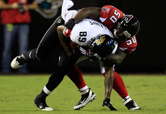 JACKSONVILLE, FL - AUGUST 19:  Marcedes Lewis #89 of the Jacksonville Jaguars attempts to run past Curtis Lofton #50 of the Atlanta Falcons during a game at EverBank Field on August 19, 2011 in Jacksonville, Florida.  (Photo by Sam Greenwood/Getty Images)