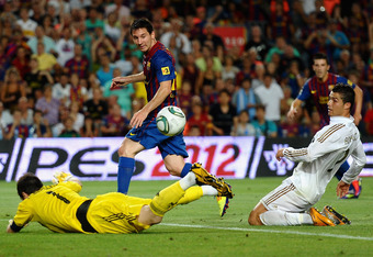 BARCELONA, SPAIN - AUGUST 17:  Lionel Messi of Barcelona scores past Iker Casillas of Real Madrid during the Super Cup second leg match between Barcelona and Real Madrid at Nou Camp on August 17, 2011 in Barcelona, Spain.  (Photo by Laurence Griffiths/Getty Images)