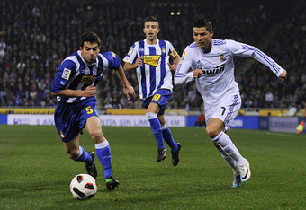 BARCELONA, SPAIN - FEBRUARY 13:  Cristiano Ronaldo (R) of Real Madrid duels for the ball against Jordi Amat of RCD Espanyol during La Liga match between RCD Espanyol and Real Madrid at Estadi Cornella-El Prat on February 13, 2011 in Barcelona, Spain.  (Photo by David Ramos/Getty Images)