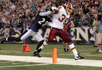 BALTIMORE, MD - AUGUST 25: Tim Hightower #39 of the Washington Redskins scores a touchdown against Tom Zbikowski #28 of the Baltimore Ravens during the first half of a preaseason game at M&T Bank Stadium on August 25, 2011 in Baltimore, Maryland.  (Photo by Rob Carr/Getty Images)