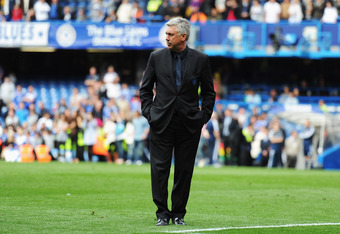 LONDON, ENGLAND - MAY 15:  Carlo Ancelotti the Chelsea manager acknowledges the home fans following the Barclays Premier League match between Chelsea and Newcastle United at Stamford Bridge on May 15, 2011 in London, England.  (Photo by Michael Regan/Getty Images)