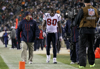 PHILADELPHIA, PA - DECEMBER 02:  Andre Johnson #80 of the Houston Texans walks down the sideline assisted by a member of the medical training staff after he was injured against the Philadelphia Eagles at Lincoln Financial Field on December 2, 2010 in Philadelphia, Pennsylvania.  (Photo by Jim McIsaac/Getty Images)