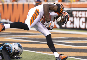CINCINNATI, OH - AUGUST 25: A.J. Green #18 of the Cincinnati Bengals keeps his balance to score a touchdown on a 40-yard reception during an NFL preseason game against the Carolina Panthers at Paul Brown Stadium on August 25, 2011 in Cincinnati, Ohio. The Bengals won 24-13. (Photo by Joe Robbins/Getty Images)