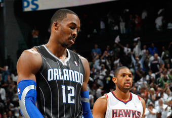 ATLANTA, GA - APRIL 28:  Dwight Howard #12 of the Orlando Magic reacts after a turnover to the Atlanta Hawks during Game Six of the Eastern Conference Quarterfinals in the 2011 NBA Playoffs at Philips Arena on April 28, 2011 in Atlanta, Georgia.  NOTE TO USER: User expressly acknowledges and agrees that, by downloading and or using this photograph, User is consenting to the terms and conditions of the Getty Images License Agreement.  (Photo by Kevin C. Cox/Getty Images)