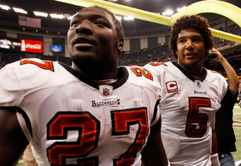 NEW ORLEANS, LA - JANUARY 02:  Quarterback Josh Freeman #5  celebrates with LeGarrette Blount #27 of the Tampa Bay Buccaneers after defeating the New Orleans Saints 23-13 at the Louisiana Superdome on January 2, 2011 in New Orleans, Louisiana.  (Photo by Chris Graythen/Getty Images)
