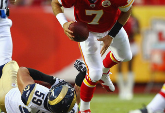 KANSAS CITY, MO - AUGUST 26: Matt Cassel #7 of the Kansas City Chiefs slips out of a tackle attempt by Ben Leber #59 of the St. Louis Rams during a pre-season game at Arrowhead Stadium  on August 26, 2011 in Kansas City, Missouri.  (Photo by Dilip Vishwanat/Getty Images)