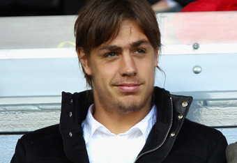 LIVERPOOL, ENGLAND - AUGUST 27:  New Liverpool signing Sebastian Coates looks on ahead of the the Barclays Premier League match between Liverpool and Bolton Wanderers at Anfield on August 27, 2011 in Liverpool, England.  (Photo by Clive Brunskill/Getty Images)