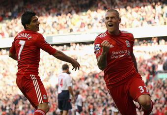LIVERPOOL, ENGLAND - AUGUST 27:  Martin Skrtel of Liverpool celebrates scoring his side's second goal during the Barclays Premier League match between Liverpool and Bolton Wanderers at Anfield on August 27, 2011 in Liverpool, England.  (Photo by Clive Brunskill/Getty Images)