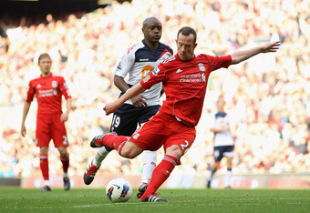 LIVERPOOL, ENGLAND - AUGUST 27:  Charlie Adam of Liverpool shoots and scores his side's third goal during the Barclays Premier League match between Liverpool and Bolton Wanderers at Anfield on August 27, 2011 in Liverpool, England.  (Photo by Clive Brunskill/Getty Images)