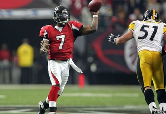 ATLANTA - OCTOBER 22:  Quarterback Michael Vick #7 of the Atlanta Falcons passes the ball during the game against the Pittsburgh Steelers on October 22, 2006 at the Georgia Dome in Atlanta, Georgia. (Photo by Doug Pensinger/Getty Images)