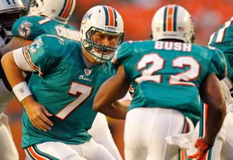 MIAMI GARDENS, FL - AUGUST 19:  Chad Henne #7 of the Miami Dolphins looks to hand off th Reggie Bush #22 during a Preseason NFL game against the Carolina Panthers at Sun Life Stadium on August 19, 2011 in Miami Gardens, Florida.  (Photo by Mike Ehrmann/Getty Images)