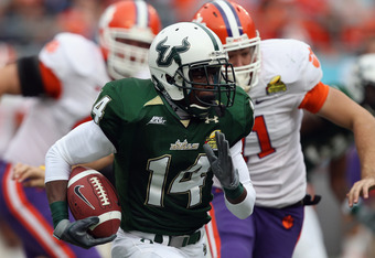 A rare shot of a USF player gaining yards at a college football game.