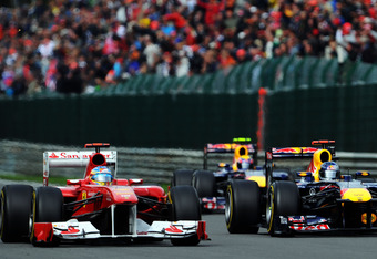 SPA FRANCORCHAMPS, BELGIUM - AUGUST 28:  Fernando Alonso (L) of Spain and Ferrari and Sebastian Vettel (R) of Germany and Red Bull Racing drive side by side during the Belgian Formula One Grand Prix at the Circuit of Spa Francorchamps on August 28, 2011 in Spa Francorchamps, Belgium.  (Photo by Lars Baron/Getty Images)