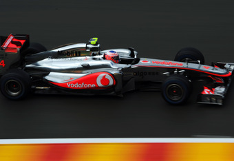 SPA FRANCORCHAMPS, BELGIUM - AUGUST 27:  Jenson Button of Great Britain and McLaren drives during qualifying for the Belgian Formula One Grand Prix at the Circuit of Spa Francorchamps on August 27, 2011 in Spa Francorchamps, Belgium.  (Photo by Lars Baron/Getty Images)