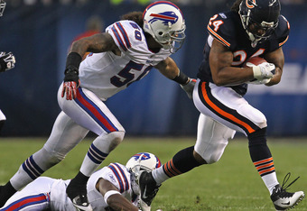 CHICAGO, IL - AUGUST 13:  Marion Barber #24 of the Chicago Bears runs for yardage past Nick Barnett #50 of the Buffalo Bills close in during a preseason game at Soldier Field on August 13, 2011 in Chicago, Illinois. The Bears defeated the Bills 10-3. (Photo by Jonathan Daniel/Getty Images)