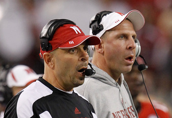 ARLINGTON, TX - DECEMBER 04:  Head coach Bo Pelini (R) of the Nebraska Cornhuskers and defensive coordinator Carl Pelini lead their team against the Oklahoma Sooners at Cowboys Stadium on December 4, 2010 in Arlington, Texas. The Sooners beat the Cornhuskers 23-20.  (Photo by Tom Pennington/Getty Images)