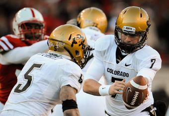 LINCOLN, NE - NOVEMBER 26: Cody Hawkins #7 hands the ball to teammate Rodney Stewart #5 of the Colorado Buffaloes during their game against the Colorado Buffaloes at Memorial Stadium on November 26, 2010 in Lincoln, Nebraska. Nebraska defeated Colorado 45-17 (Photo by Eric Francis/Getty Images)