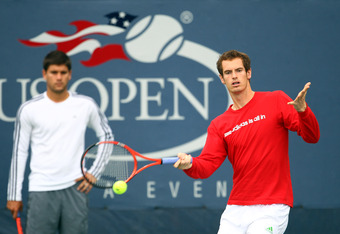 Andy Murray of Great Britain plays a forehand in a practice session as Daniel Vallverdu watches behind during previews at USTA Billie Jean King National Tennis Center on August 27, 2011 in New York City.