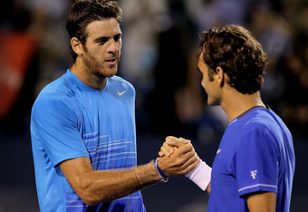 Juan Martin Del Potro of Argentina (L) congratulates Roger Federer of Switzerland after their match during the Western & Southern Open at the  Lindner Family Tennis Center on August 16, 2011 in Mason, Ohio.