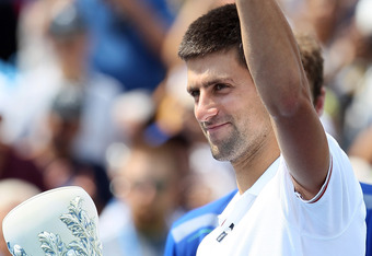 Novak Djokovic of Serbia holds up his trophy after he retired in the second set against Andy Murray of Great Britain during the Western & Southern Open at the Lindner Family Tennis Center on August 21, 2011 in Mason, Ohio.