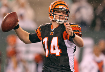 EAST RUTHERFORD, NJ - AUGUST 21:  Andy Dalton #14 of the Cincinnati Bengals looks to pass against the New York Jets during their pre season game on August 21, 2011 at the New Meadowlands Stadium in East Rutherford, New Jersey.  (Photo by Al Bello/Getty Images)