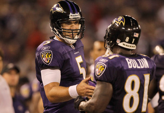 BALTIMORE, MD - AUGUST 25: Quarterback Joe Flacco #5 of the Baltimore Ravens celebrates with Anquan Boldin #81 after the pair connected for a touchdown against the Washington Redskins during the second half of a preseason game at M&T Bank Stadium on August 25, 2011 in Baltimore, Maryland. The Ravens defeated the Redskins 34-31.  (Photo by Rob Carr/Getty Images)