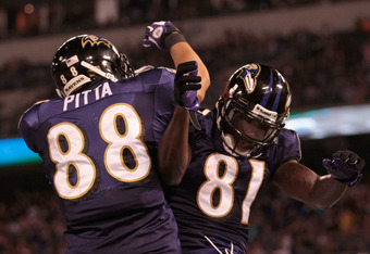 BALTIMORE, MD - AUGUST 25: Dennis Pitta #88 of the Baltimore Ravens celebrates with Anquan Boldin #81 after Boldin scored a touchdown against the Washington Redskins during the second half of a preseason game at M&T Bank Stadium on August 25, 2011 in Baltimore, Maryland. The Ravens defeated the Redskins 34-31.  (Photo by Rob Carr/Getty Images)