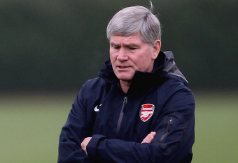 ST ALBANS, ENGLAND - NOVEMBER 22:  Arsenal manager Arsene Wenger talks to his assistant Pat Rice during Arsenal training ahead of their UEFA Champions League match against Braga at London Colney on November 22, 2010 in St Albans, England.  (Photo by Scott Heavey/Getty Images)