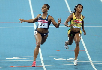 DAEGU, SOUTH KOREA - AUGUST 29:  Carmelita Jeter of United States sprints to victory in the women's 100 metres final  during day three of 13th IAAF World Athletics Championships at the Daegu Stadium on August 29, 2011 in Daegu, South Korea.  (Photo by Mic