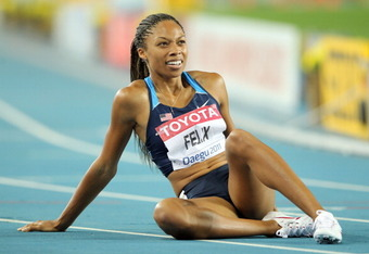 DAEGU, SOUTH KOREA - AUGUST 29:  Allyson Felix of United States recovers after competing in the women's 400 metres final during day three of the 13th IAAF World Athletics Championships at the Daegu Stadium on August 29, 2011 in Daegu, South Korea.  (Photo
