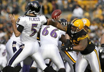 PITTSBURGH - DECEMBER 27: LaMarr Woodley #56 of the Pittsburgh Steelers disrupts the throwing arm of Joe Flacco #5 of the Baltimore Ravens on December 27, 2009 at Heinz Field in Pittsburgh, Pennsylvania. Pittsburgh won the game 23-20. (Photo by Gregory Sh