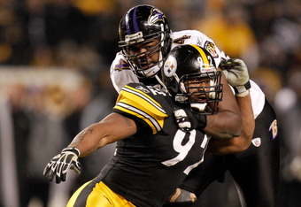 PITTSBURGH, PA - JANUARY 15:  Linebacker James Harrison #92 of the Pittsburgh Steelers rushes against offensive tackle Michael Oher #74 of the Baltimore Ravens during the AFC Divisional Playoff Game at Heinz Field on January 15, 2011 in Pittsburgh, Pennsy