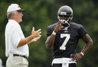 GREENVILLE, SC - JULY 29:   Head coach Dan Reeves of the Atlanta Falcons talks with quarterback Michael Vick #7 during the Atlanta Falcons training camp on July 29, 2003 at Furman University in Greenville, South Carolina.  (Photo by Jamie Squire/Getty Ima