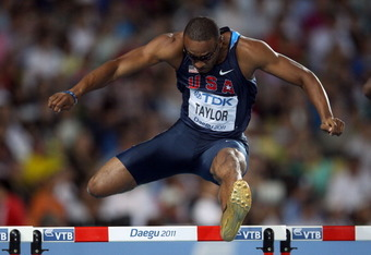 DAEGU, SOUTH KOREA - AUGUST 30: Angelo Taylor of United States competes in the men's 400 metres hurdles semi finals during day four of the 13th IAAF World Athletics Championships at the Daegu Stadium on August 30, 2011 in Daegu, South Korea.  (Photo by Ch