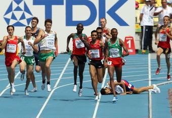 DAEGU, SOUTH KOREA - AUGUST 30:  Mekonnen Gebremedhin of Ethiopia leads as Mehdi Baala of France falls during the men's 1500 metres heats during day four of the 13th IAAF World Athletics Championships at the Daegu Stadium on August 30, 2011 in Daegu, Sout