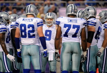 MINNEAPOLIS, MN - AUGUST 27: Tony Romo #9 of the Dallas Cowboys speaks with his teammates durning the game against the Minnesota Vikings on August 27, 2011 at Hubert H. Humphrey Metrodome in Minneapolis, Minnesota. (Photo by Hannah Foslien/Getty Images)