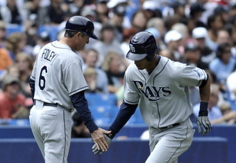 TORONTO, CANADA - AUGUST 28:  Desmond Jennings #8 of the Tampa Bay Rays celebrates a home run with third base coach Tom Foley #6 during MLB game action against the Toronto Blue Jays August 28, 2011 at Rogers Centre in Toronto, Ontario, Canada. (Photo by B
