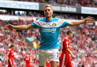 LIVERPOOL, ENGLAND - AUGUST 13:  Sebastian Larsson of Sunderland celebrates scoring the equalising goal during the Barclays Premier League match between Liverpool and Sunderland at Anfield on August 13, 2011 in Liverpool, England.  (Photo by Clive Brunski