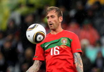 CAPE TOWN, SOUTH AFRICA - JUNE 21:  Raul Meireles of Portugal controls the ball during the 2010 FIFA World Cup South Africa Group G match between Portugal and North Korea at the Green Point Stadium on June 21, 2010 in Cape Town, South Africa.  (Photo by D