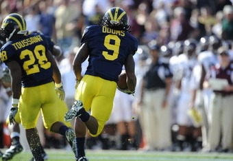 JACKSONVILLE, FL - JANUARY 01:  Martavious Odoms # 9 of the Michigan Wolverines returns a kick against the Mississippi State Bulldogs during the Gator Bowl at EverBank Field on January 1, 2011 in Jacksonville, Florida  (Photo by Rick Dole/Getty Images)