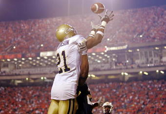 AUBURN, AL - SEPTEMBER 3:  Wide receiver Calvin Johnson #21 of the Georgia Tech Yellow Jackets fails to catch a pass in the end zone against defensive back Patrick Lee #20 of the Auburn Tigers in the fourth quarter on September 3, 2005 at Jordan-Hare Stad