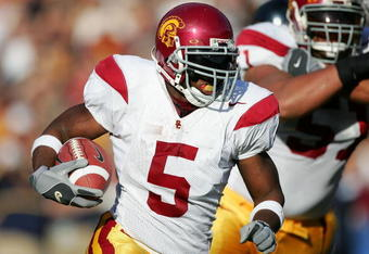 BERKELEY, CA - NOVEMBER 12:  (FILE PHOTO) Reggie Bush #5 of the USC Trojans runs with the ball against the California Golden Bears at Memorial Stadium on November 12th, 2005 in Berkeley, California. Bush was picked second overall by the New Orleans Saints