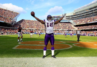 CHICAGO - NOVEMBER 14: Percey Harvin #12 of the Minnesota Vikings celebrates a touchdown catch against the Chicago Bears at Soldier Field on November 14, 2010 in Chicago, Illinois. The Bears defeated the Vikings 27-13. (Photo by Jonathan Daniel/Getty Imag