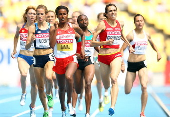 DAEGU, SOUTH KOREA - AUGUST 28:  Nuria Fernández (R) of Spain and Maryam Yusuf Jamal of Bahrain lead the pack during the women's 1500 metres heats during day two of the 13th IAAF World Athletics Championships at the Daegu Stadium on August 28, 2011 in Dae