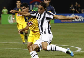 NEW YORK - JULY 26:  Alessandro Matri #32 of Juventus FC moves the ball in front of Erik Pimentel #32 of Club America during an exhibition match on July 26, 2011 at Citi Field in the Flushing neighborhood of the Queens borough of New York City.  (Photo by