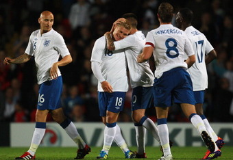 LONDON, ENGLAND - SEPTEMBER 01:  Martyn Waghorn of England celebrates with his team-mates after scoring the fifth goal for England during the UEFA European Under-21 Championship Qualifier Group 8 match between England and Azerbaijan at Vicarage Road on Se